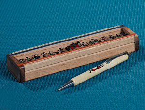 Pen and Box with Tribal Figurines