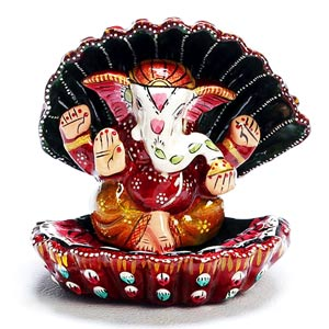Enamelled Metal Ganesha Murti seated in a Sea Shell