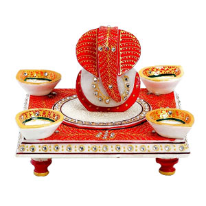 Diyas and Ganeshaji Seated on Chowki with Kundans