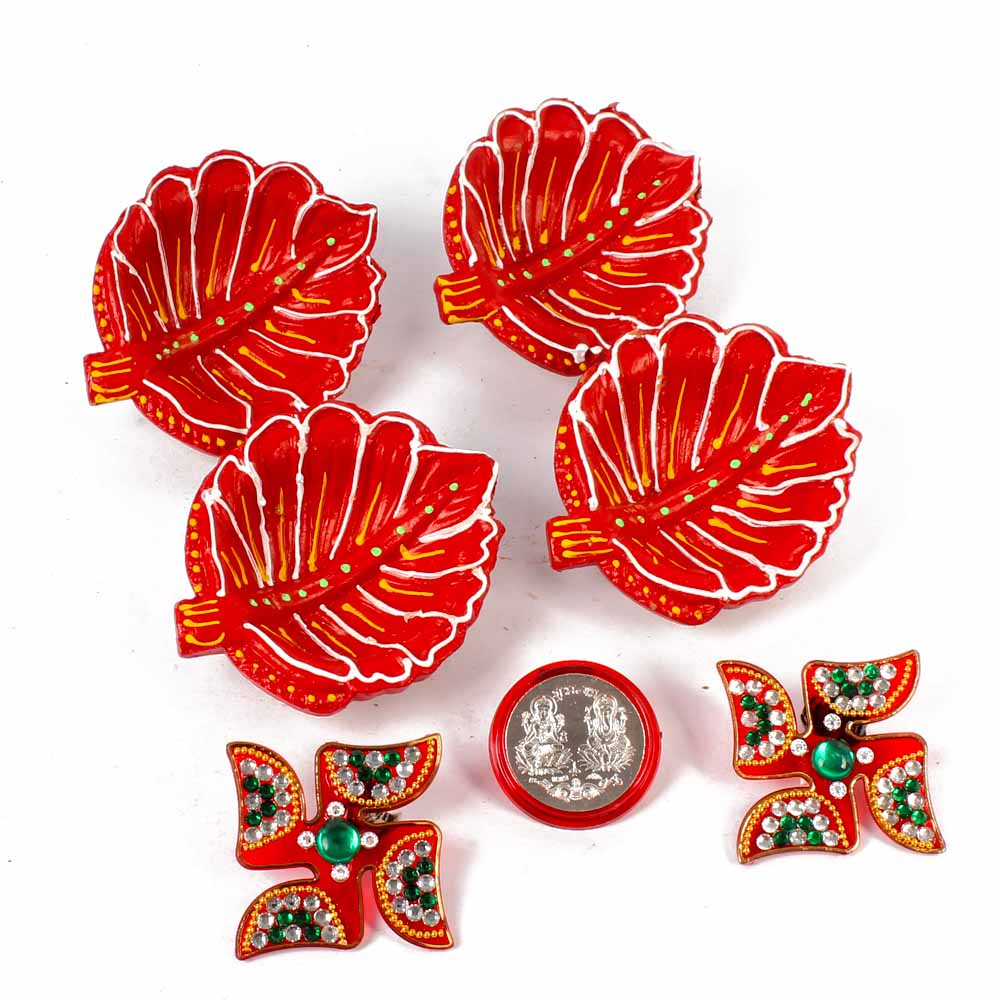 Leaf Shaped Diyas with Shubh Swastika and Silver Plated Lakshmi Ganesha Coin.