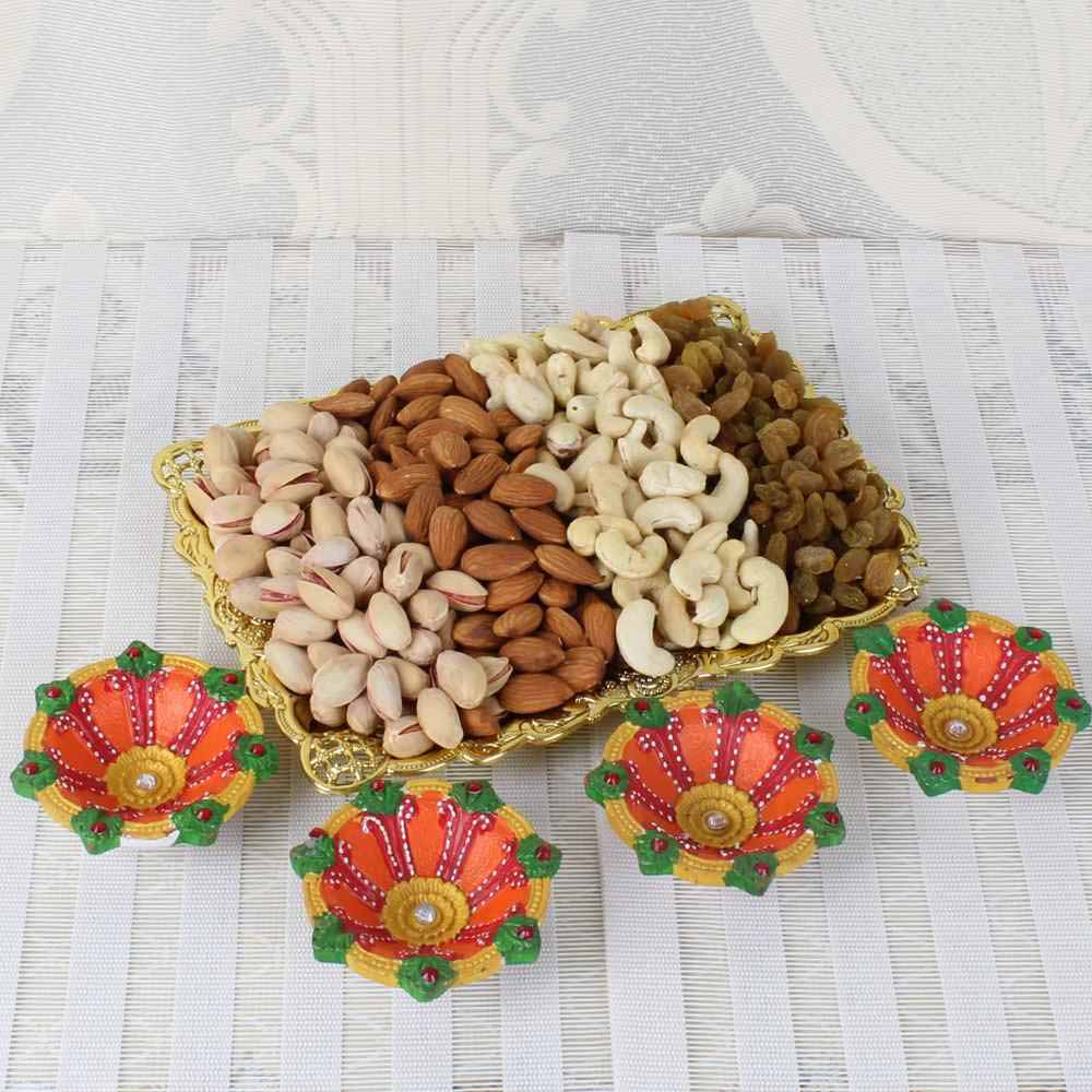 Flowers with Dryfruits-One Kg Assorted Dry fruit Tray with Four Earthen Diyas
