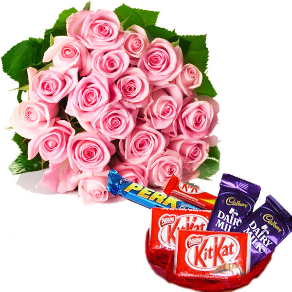 Chocolates and pink roses