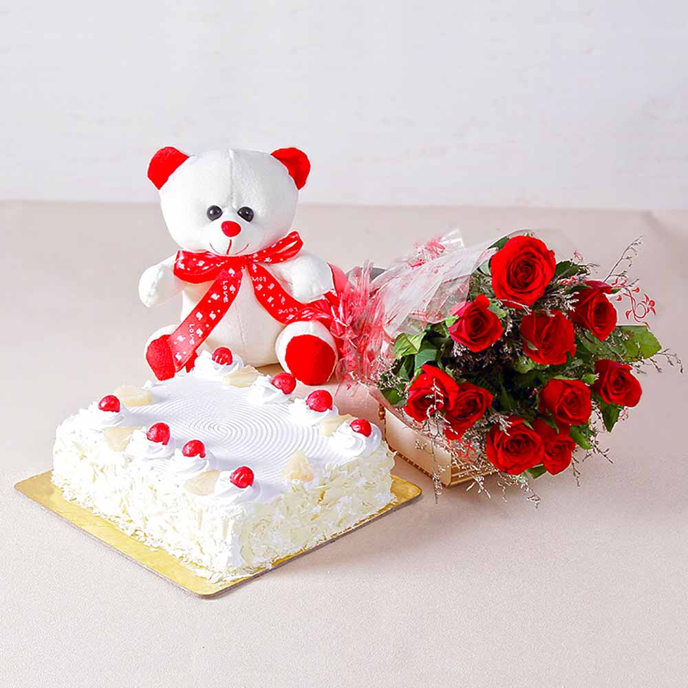 Flower Hampers-Ten Romantic Red Roses with One Kg Pineapple cake and Teddy Bear