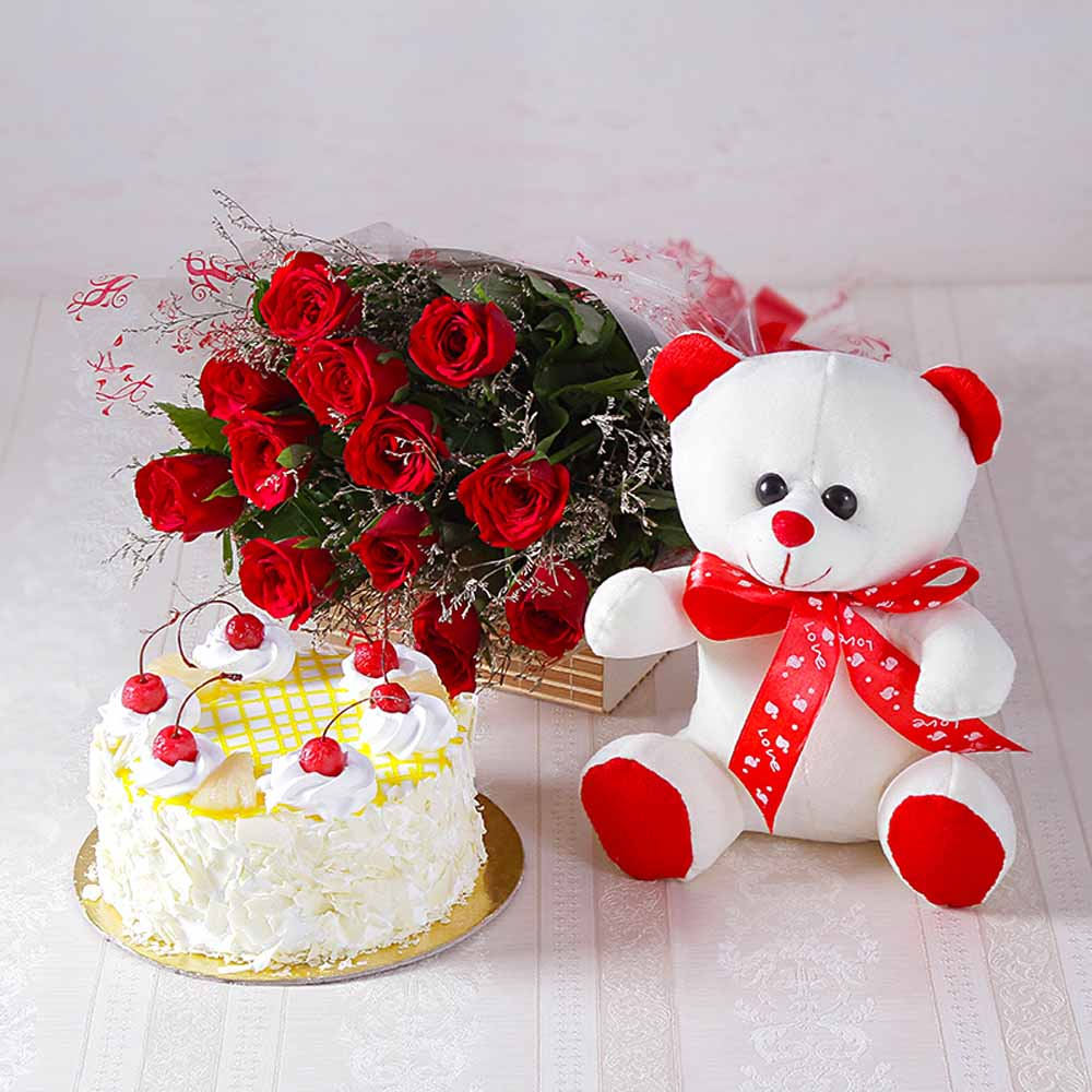 Forever Red Roses with Half kg Pineapple cake and Soft Toy