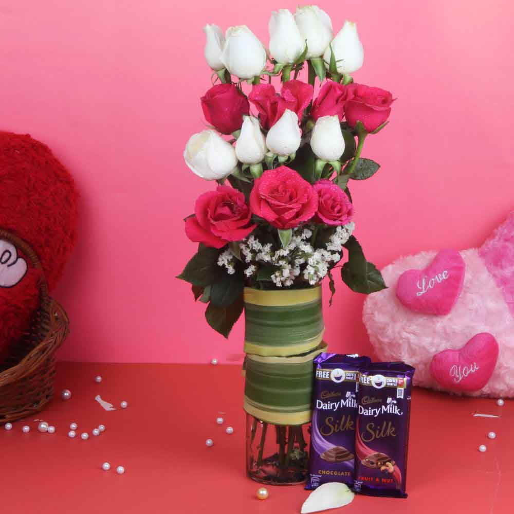 Glass Vase of Pink and White Roses and Chocolates