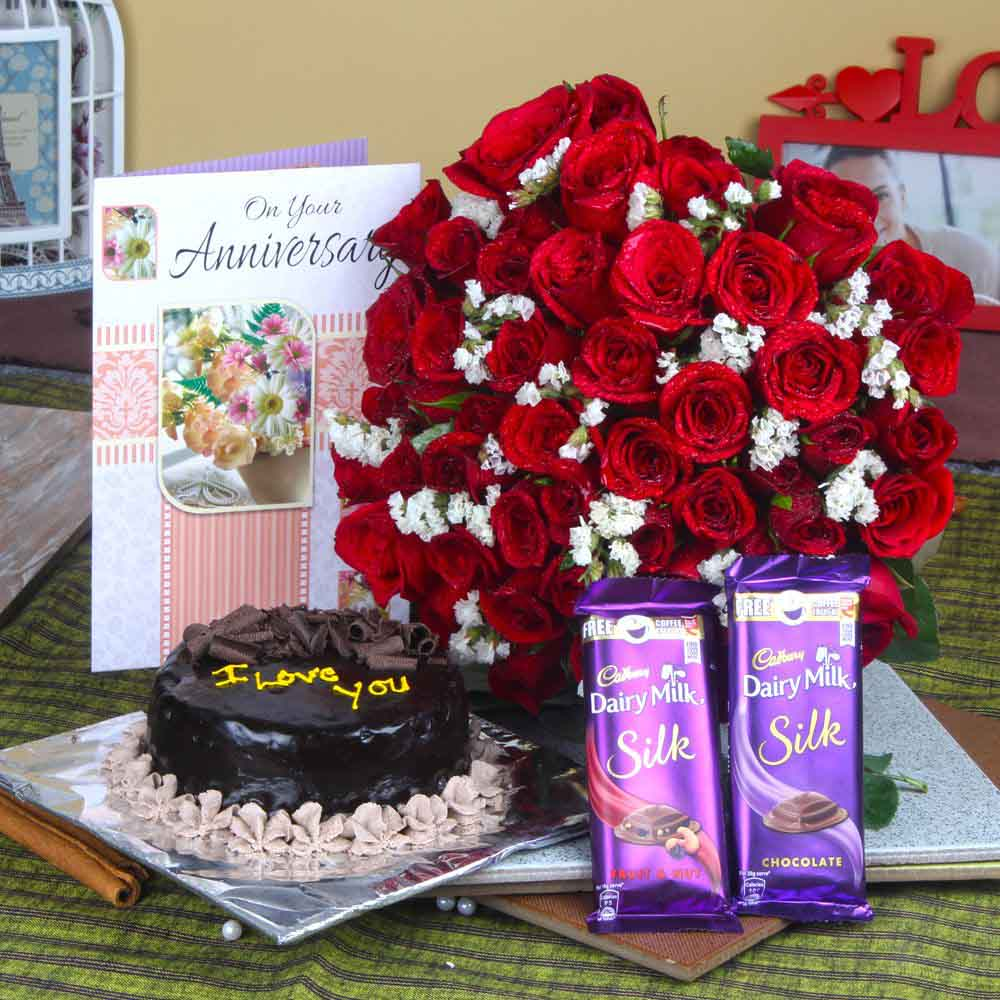 Cakes & Flowers-Fifty Red Roses Hand Bunch and Anniversary cake with Chocolates