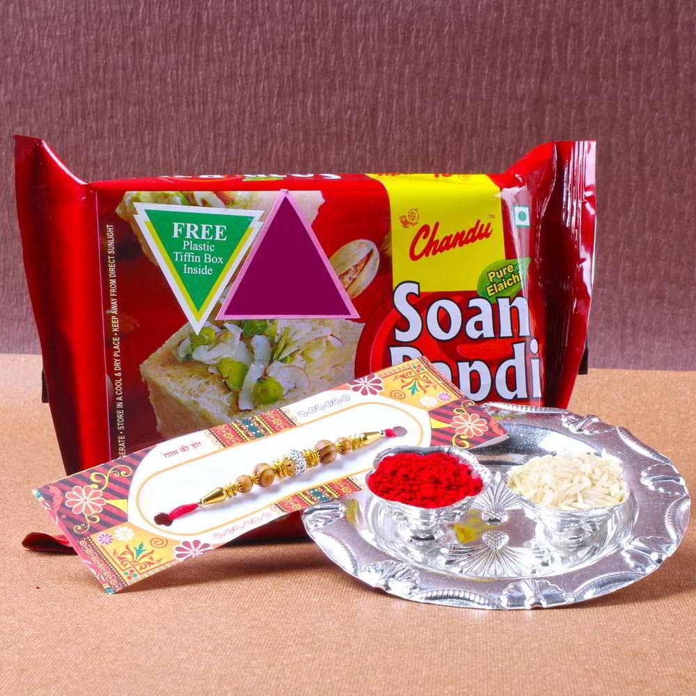 Rakhi Hampers-Small Silver Shiny Rakhi Thali with Soan Papadi