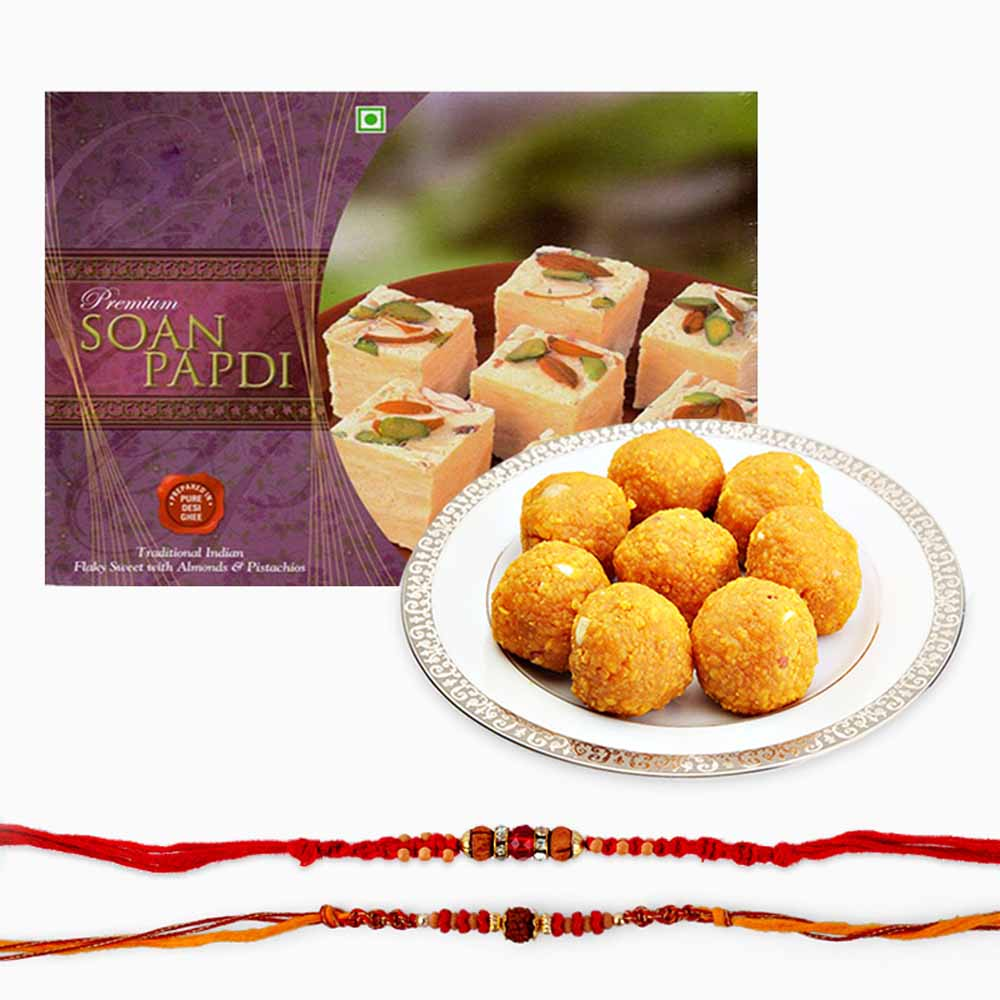 Rakhi Flower Hampers-Delicious Sweets and Set of Two Rakhi