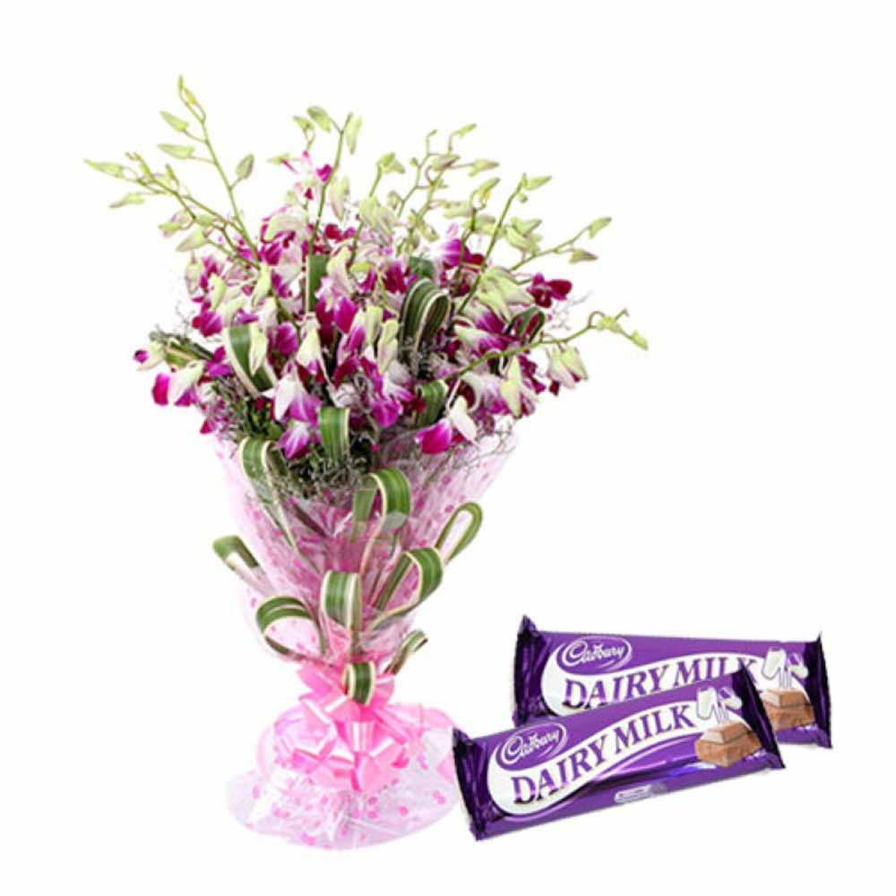 Valentine Flowers-Orchids Bouquet And Dairymilk Chocolates For Your Valentine