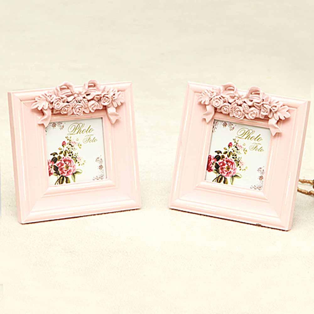 Pink wooden frames (set of 2)
