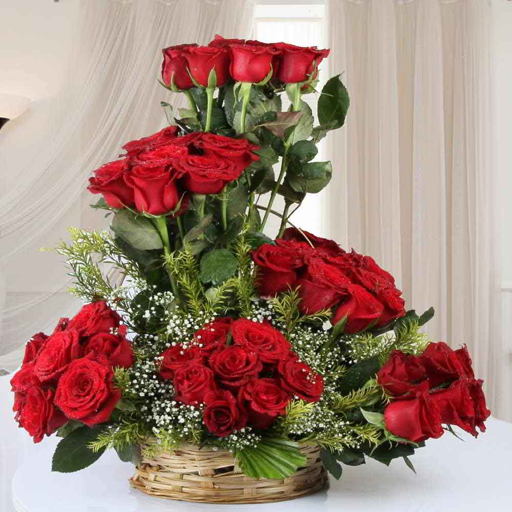 Designer Arrangement of Fifty Red Roses in Basket