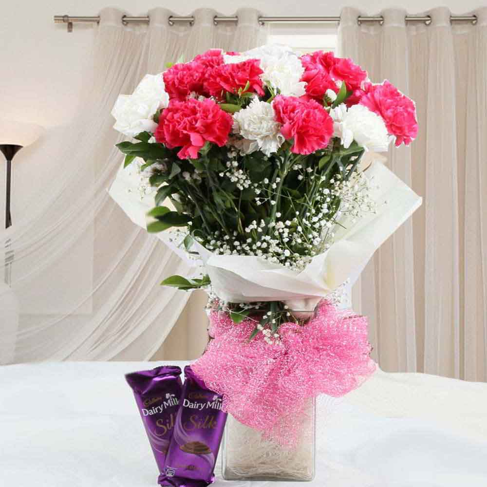 Flowers & Chocolates-Tasty Cadbury Silk Chocolates and vase of Carnations Combo