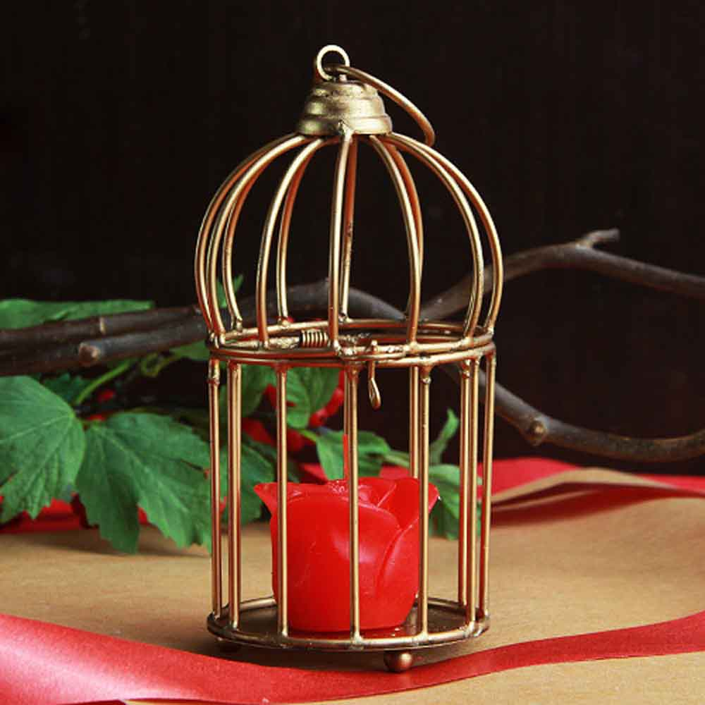 Rose candle in cage arrangement