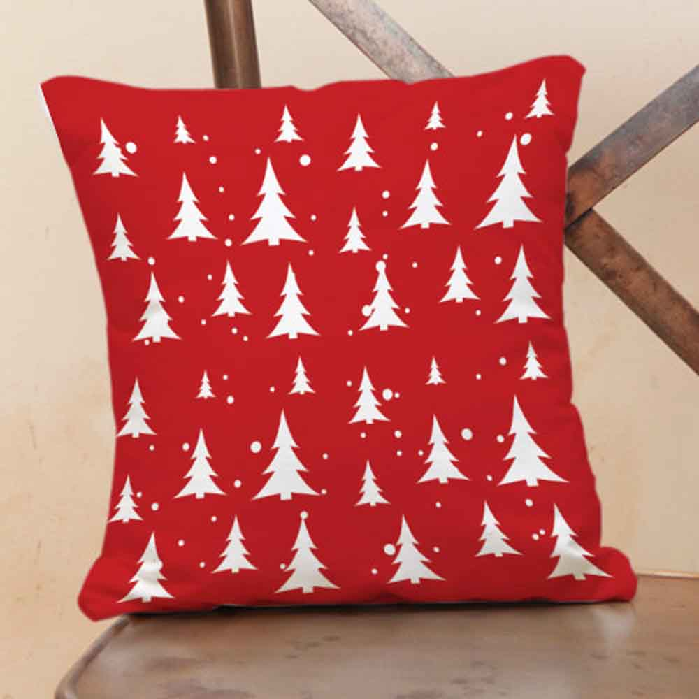 Red cushion with X-Maa tree prints