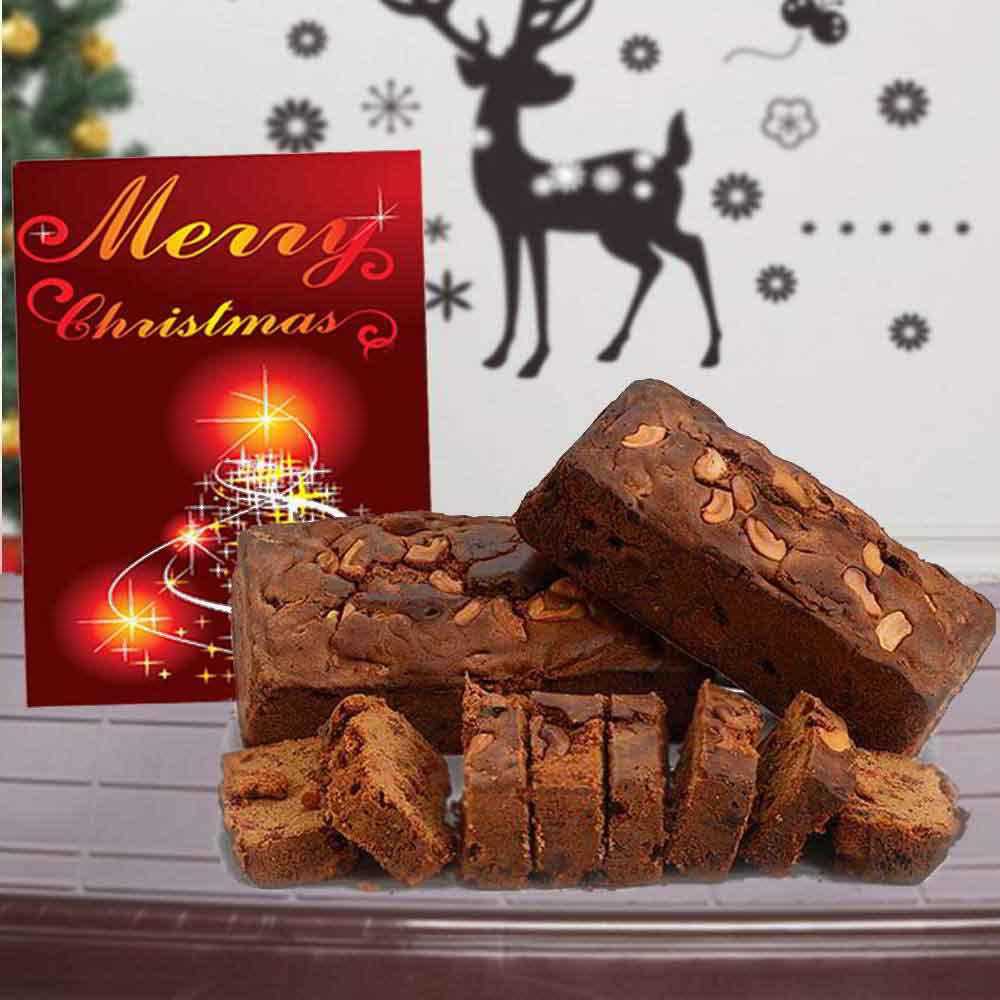 Cashew Plum Cake with Merry Christmas Greeting Card